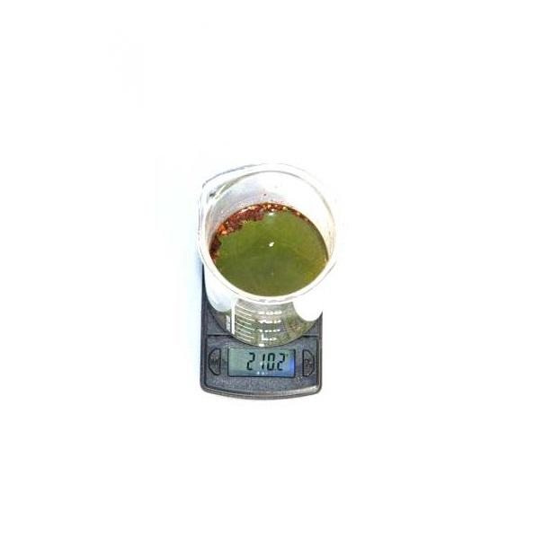 Weegschaal-bekerglas-groene-alcohol